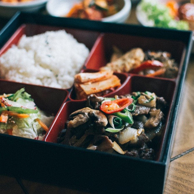Take away box with variety of Korean food